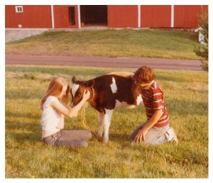 My brother and I with one of the calves we raised at the farm.